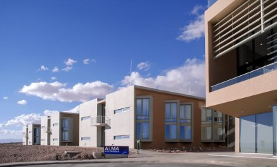 The ALMA Residencia at the ALMA Operations Support Facility acts as accommodation for visitors and staff. The building was handed over to the Joint ALMA Observatory in April 2017. The celebration event was attended by the ALMA Board and the directors of the three executives — ESO, NAOJ and NRAO. The architects who designed the building were also present. The ALMA Residencia is the last major construction item to be delivered to the ALMA project by ESO.